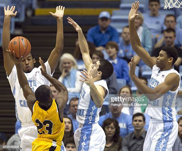 North Carolina's Desmond Hubert Luke Davis and Isaiah Hicks defend against Northern Kentucky's Todd Johnson during the second half at the Smith...