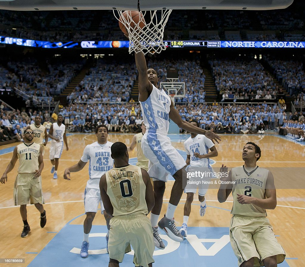 North Carolina's Dexter Strickland (1) drives to the basket against Wake Forest's Codi Miller-McIntyre (0) in the first half at the Smith Center in Chapel Hill, North Carolina, Tuesday, February 5, 2013.