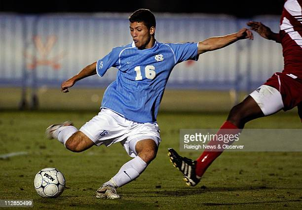 North Carolina's Enzo Martinez loads up a shot during the second half against North Carolina State in the Atlantic Coast Conference Men's Soccer...