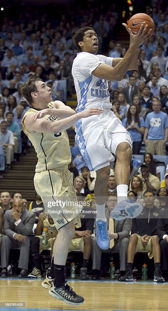 North Carolina's James Michael McAdoo (43) drives to the basket against Wake Forest's Tyler Cavanaugh (34) during first-half action at the Smith Center in Chapel Hill, North Carolina, Tuesday, February 5, 2013.