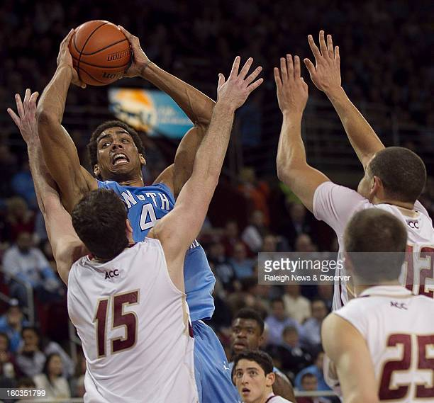 North Carolina's James Michael McAdoo muscles over Boston College's Andrew Van Nest for a shot during the first half at the Conte Forum in Chestnut...