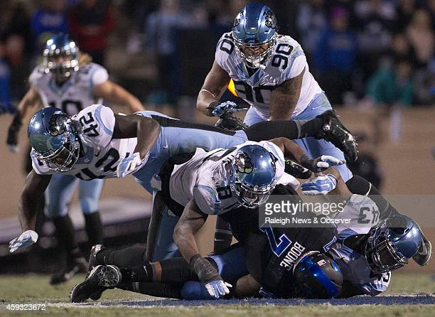 North Carolina's Jessie Rogers Norkeithus Otis sack Duke quarterback Anthony Boone for a loss of 9 yards in the second quarter on Thursday, Nov. 20...