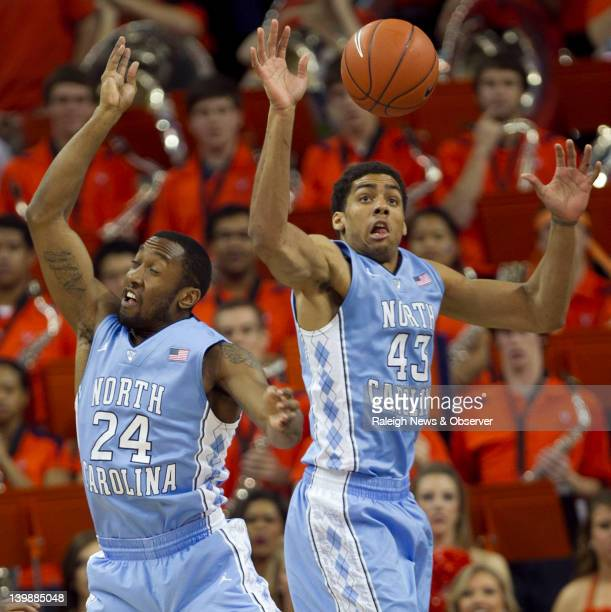 North Carolina's Justin Watts and James Michael McAdoo go after a defensive rebound in during the first half against Virginia at John Paul Jones...