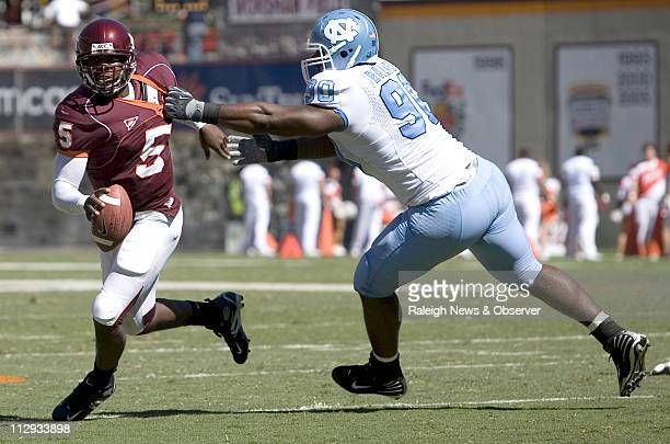 North Carolina's Kentwan Balmer gets a hand on Virginia Tech quarterback Tyrod Taylor as he head towards the end zone to score a touchdown in the...