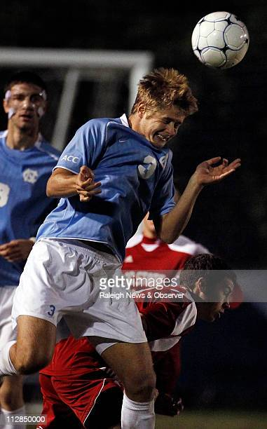 North Carolina's Kirk Urso heads the ball against North Carolina State's Chandler Knox in the second half in the Atlantic Coast Conference Men's...