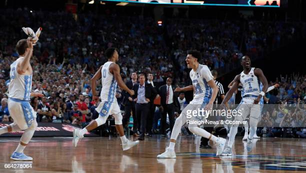 North Carolina's Nate Britt Justin Jackson and Theo Pinson celebrate UNC's victory over Gonzaga in the NCAA Division I men's basketball national...