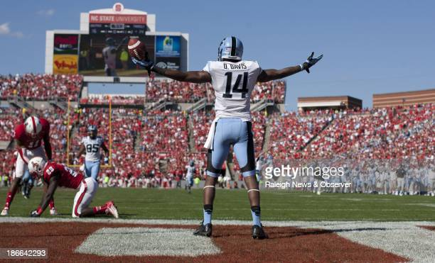 North Carolina's Quinshad Davos celebrates a touchdown against NC State during the second quarter at CarterFinley Stadium in Raleigh North Carolina...