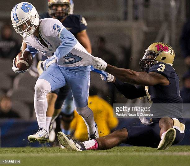 North Carolina's Ryan Switzer left picks up 26 yards on a pass from quarterback Marquise Williams before being stopped by Pittsburgh's Nicholas...