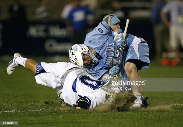 North Carolina's Shane Walterhoefer wins a faceoff against Duke's Brad Ross during the semifinals of the 2007 ACC Men's Lacrosse Tournament Friday...
