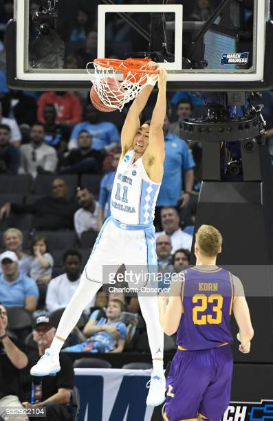 North Carolina's Shea Rush gets a dunk past Lipscomb's Aaron Korn late in the game during the first round of the NCAA Tournament at the Spectrum...
