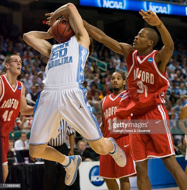 North Carolina's Tyler Hansbrough is fouled by Radford's Eric Hall in the first half on Thursday, March 19, 2009. The Tar Heels defeated the...