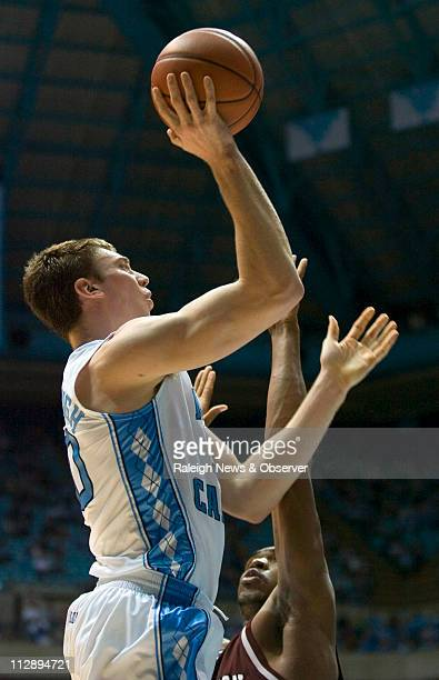 North Carolina's Tyler Hansbrough puts up a shot over College of Charleston's Dustin Scott during the second half at the Smith Center in Chapel Hill...