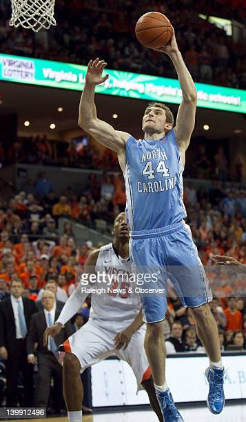 North Carolina's Tyler Zeller dunks late in the second half to help secure the Tar Heels' 5451 victory over Virginia at John Paul Jones Arena in...