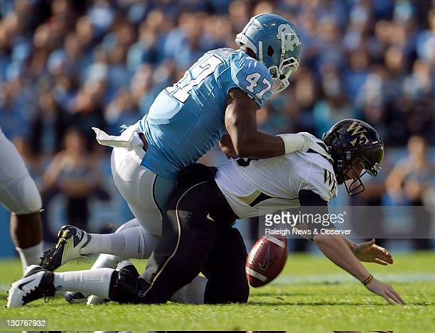 North Carolina's Zach Brown forces a fumble by Wake Forest quarterback Tanner Price in the first quarter at Kenan Stadium in Chapel Hill North...