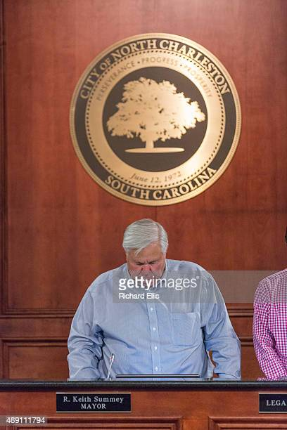 North Charleston Mayor Keith Summey bows his head in prayer before a City Council meeting on April 9 2015 in North Charleston South Carolina The City...