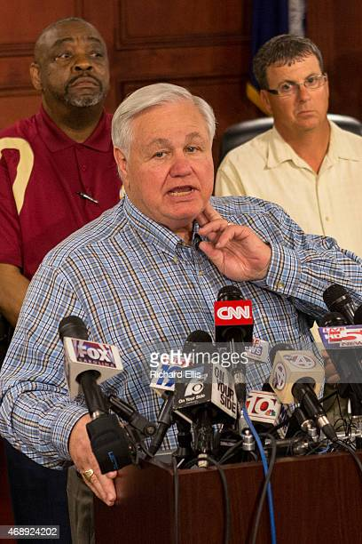 North Charleston Mayor Keith Summey demonstrates how an officer checked the pulse of shooting victim Walter Scott during a press conference on April...