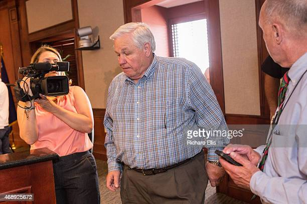 North Charleston Mayor Keith Summey makes his way through the crowd of media to a press conference on April 8 2015 in North Charleston South Carolina...