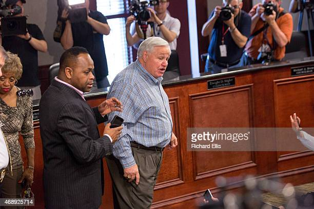 North Charleston Mayor Keith Summey makes his way through the crowd of media following a press conference on April 8 2015 in North Charleston South...