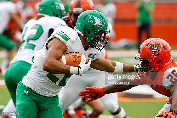North Dakota Fighting Hawks running back John Santiago runs with the ball during game action between the North Dakota Fighting Hawks and the Bowling...