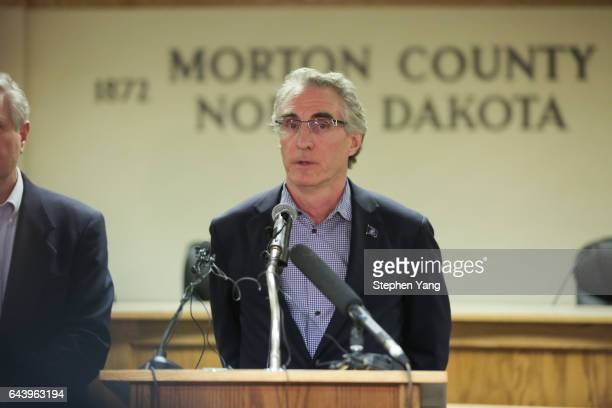 North Dakota Governor Doug Burgum speaks during a press conference announcing plans for the clean up of the Oceti Sakowin protest camp on February...
