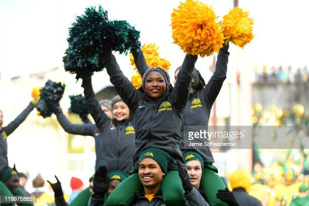 North Dakota State Bison cheerleaders root for their team against the James Madison Dukes during the Division I FCS Football Championship held at...