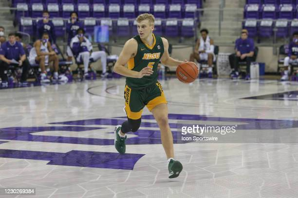 North Dakota State Bison guard Sam Griesel brings the ball up court during the game between TCU and North Dakota State on December 22, 2020 at Ed &...