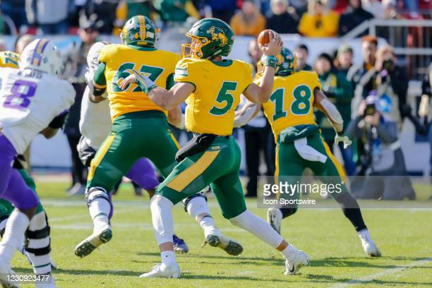 North Dakota State Bison quarterback Trey Lance looks downfield for an open receiver during the NCAA Division I Football Championship Game between...