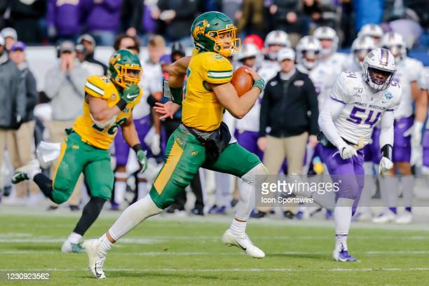 North Dakota State Bison quarterback Trey Lance runs for a first down during the NCAA Division I Football Championship Game between the North Dakota...