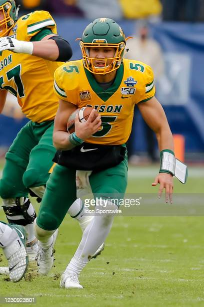 North Dakota State Bison quarterback Trey Lance runs through the line of scrimmage during the NCAA Division I Football Championship Game between the...