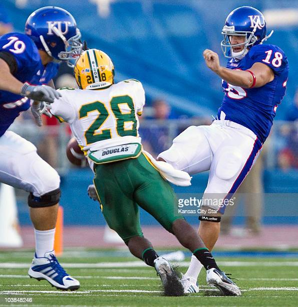 North Dakota State's Mike Sigers blocks a punt by Kansas punter Alonso Rojas in the second quarter at Memorial Stadium in Lawrence Kansas on Saturday...