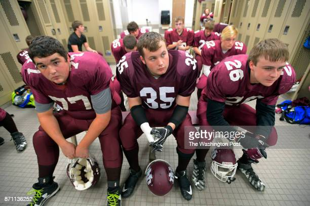North Dickinson players Jacob Butterfield left Michael Miller center and Matthew Bruette sit in the front row as they listen to the game play in the...