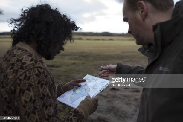 North Doddinton site Manager Andy Howard checks over the tree planting map with planters from 'The Forestry Workers' CoOperative' on March 22 2018 in...