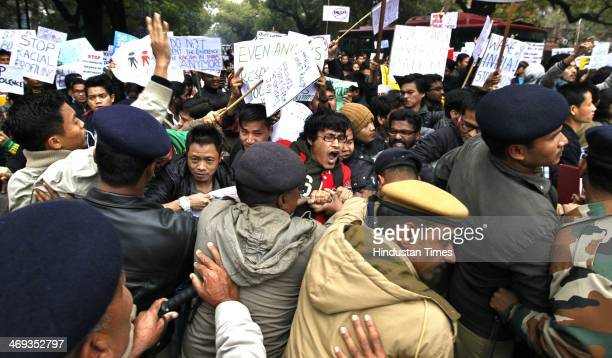 North East students participate in a protest demonstration condemning the killing of North East student Nido Taniam and rape of a minor girl from...