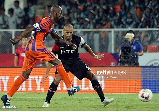 North East United FC in action against Pune City FC defender during the Indian Super League match at Shree Shiv Chhatrapati Sports Complex Stadium on...