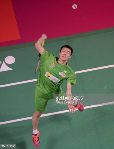 North Eastern Warriors player Tzu Wei Wang of Taiwan plays a shot against Bengaluru Blasters player Viktor Axelsen of Denmark during their Premier...