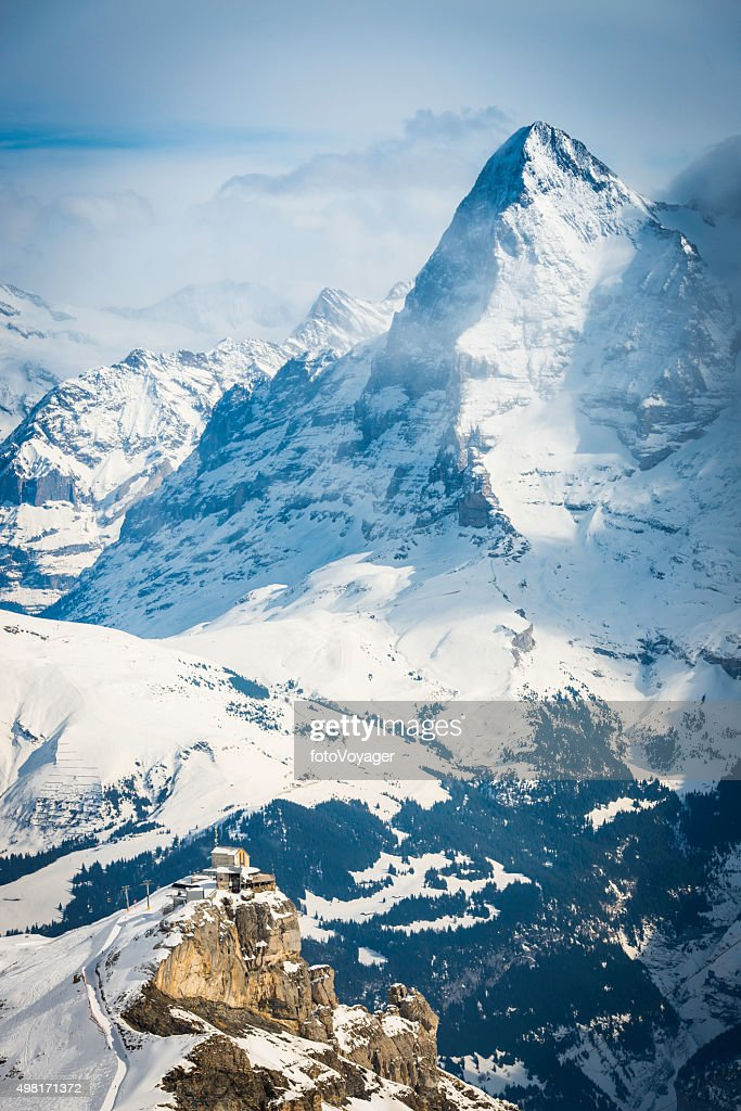 Eiger stock photos and pictures getty images north face eiger towering over mountain cable car alps switzerland reheart Images
