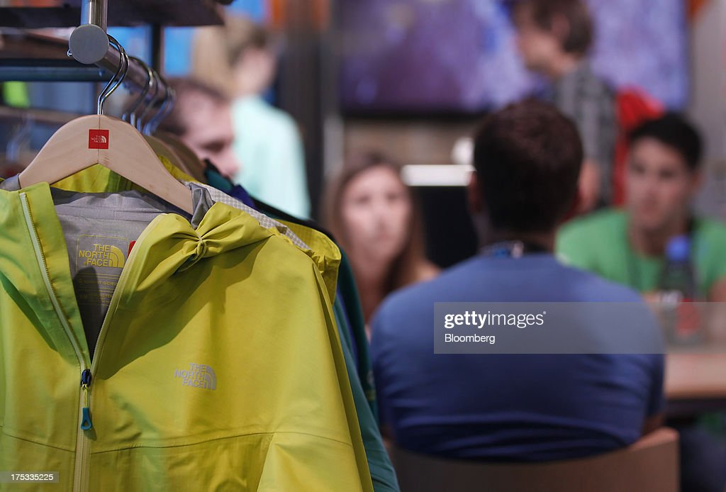 North Face Inc. jackets are displayed at the company's booth during the Outdoor Retailer Summer Market show in Salt Lake City, Utah, U.S., on Thursday, Aug. 1, 2013. Consumer spending in the U.S. rose in line with forecasts in June as Americans' incomes grew, a sign the biggest part of the economy is withstanding fiscal headwinds. Photographer: George Frey/Bloomberg via Getty Images
