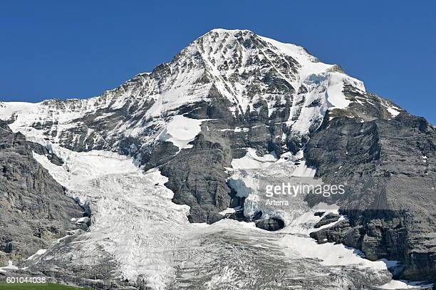 North face of the Monch forms part of a mountain ridge between the Jungfrau and the Eiger in the Bernese Alps Switzerland