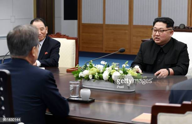 North Koraen Leader Kim Jong Un speaks with South Korean President Moon Jaein during the InterKorean Summit at the Peace House on April 27 2018 in...