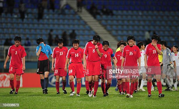 North Korea are dejected at the end of the FIFA U17 Women's World Cup Semi Final match between North Korea and Japan at the Ato Boldon Stadium on...