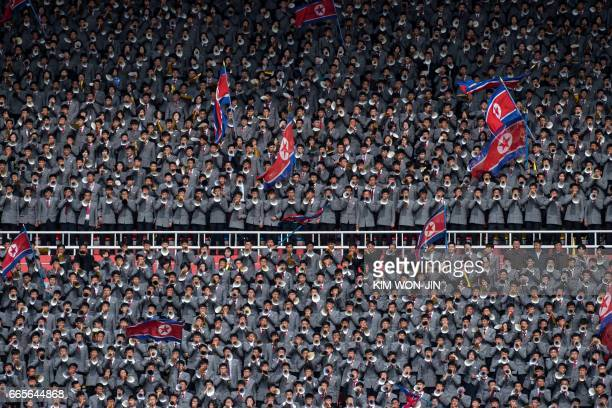North Korea fans wave flags as they support their team against South Korea during their AFC Women's 2018 Asian Cup Group B qualifying football match...