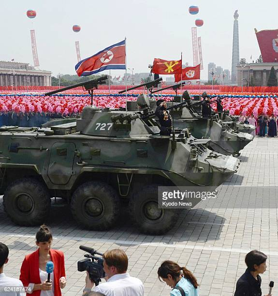 North Korea - Foreign journalists cover a military parade in Kim Il Sung Square, Pyongyang, on July 27 the 60th anniversary of the signing of a truce...