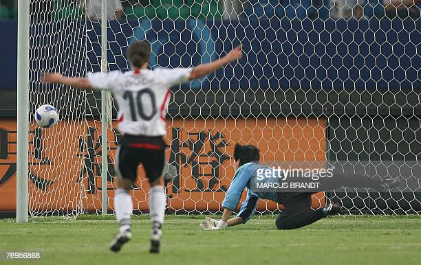 North Korea goalkeeper Jon Myong Hui tries to catch the ball shot by Kerstin Garefrekes of Germany during the 2007 FIFA Women's World Cup soccer...