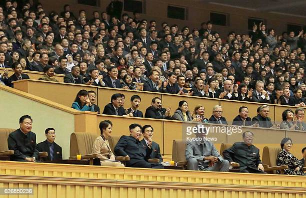 PYONGYANG North Korea North Korean leader Kim Jong Un and his wife Ri Sol Ju watch an exhibition basketball game between American and North Korean...