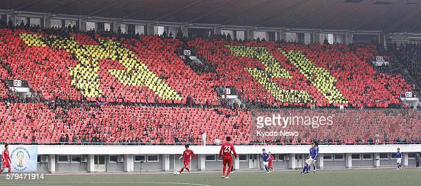 PYONGYANG North Korea North Korean soccer fans form human letters during a World Cup qualifier between North Korea and Japan at Pyongyang's Kim Il...