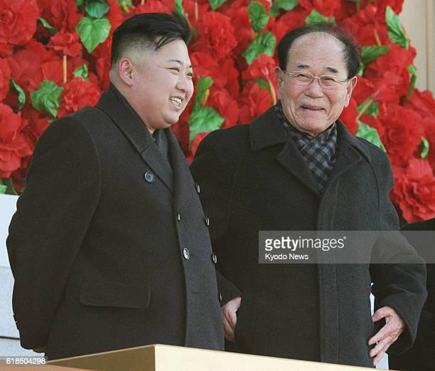 PYONGYANG North Korea North Korea's new leader Kim Jong Un chats with Kim Yong Nam president of the Presidium of the Supreme People's Assembly the...