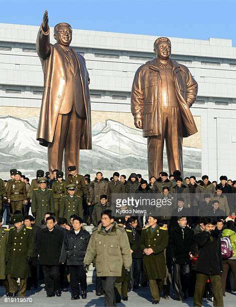 PYONGYANG North Korea People visit bronze statues of North Korea's late leader Kim Jong Il and his father and state founder Kim Il Sung on Mansu Hill...