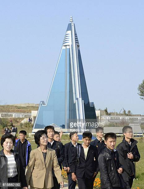 PYONGYANG North Korea People visit the Pyongyang Folk Park in Pyongyang on Oct 12 2012 Visible in the background is a model of the Ryugyong Hotel...