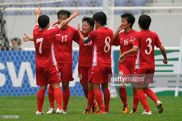 North Korea players celebrate first goal by Choe Mi Gyong during the London Olympic Women's Football Asian Qualifier match between North Korea and...