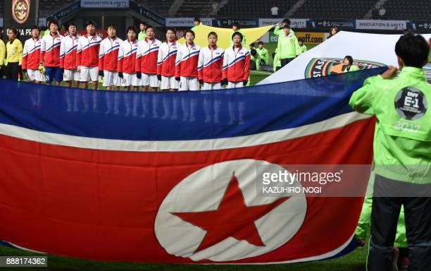 North Korea players sing their national anthem prior to their women's football match between North Korea and China at the EAFF E1 football...
